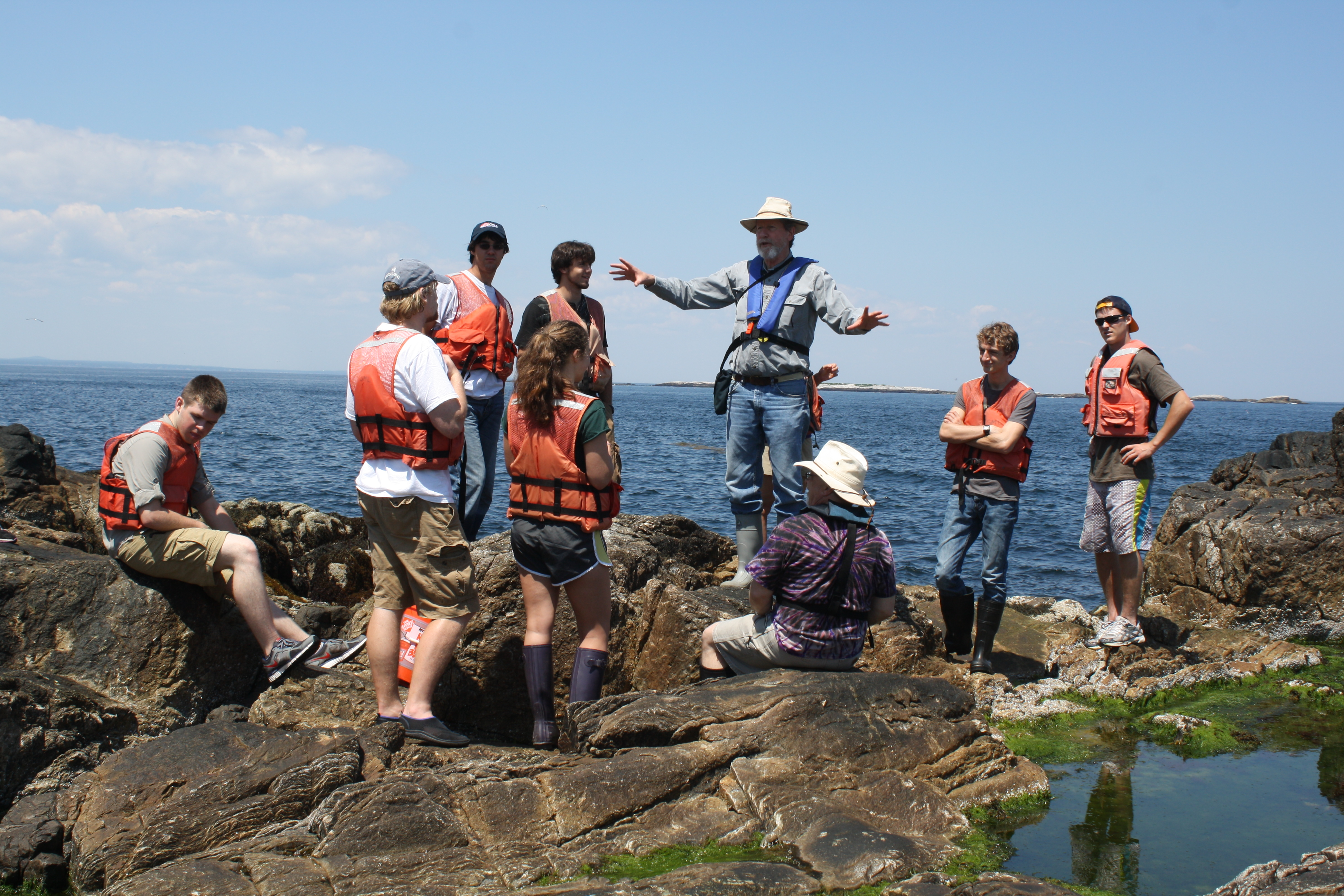 Students attending a lecture on the rocks at Appledore.