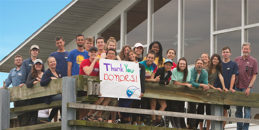 Photo of SML students with a Thank You Donors sign