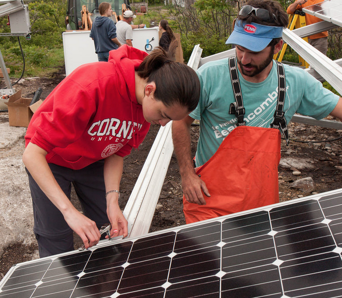 Interns install solar panels