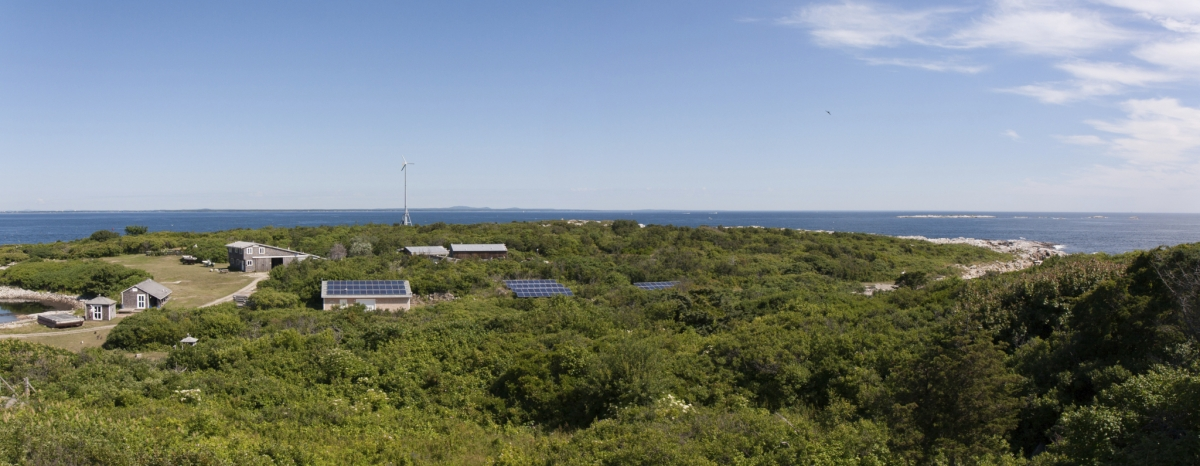 Photograph of modern day Appledore Island with new solar panel arrays and wind turbine